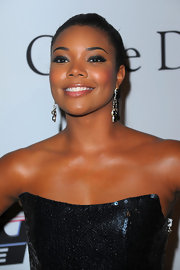 Gabrielle paired her sequin embellished dress with dangling gemstone earrings.