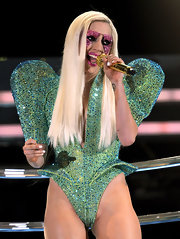 Lady Gaga styled her hair in a straight hairstyle that was parted down the side.