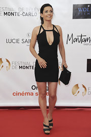 Adeline Blodieau looked jaw-droppingly sexy in her black cutout bandage dress.