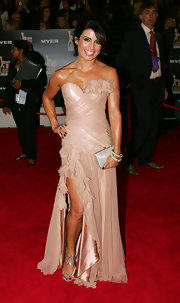 Ada Nicodemou showed off the nearly nude look which she finished off with a few ruffled touches. Her strapless dress looked great on her svelte figure.