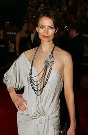 Kat Stewart showed off this stunning diamond necklace, which was beautiful, but not the best look for her draped dress.