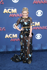 Lauren Alaina paired her dress with a black velvet clutch by Tyler Ellis.