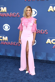 Eve went the sweet route in a ruffled pink cold-shoulder gown by Prabal Gurung at the 2018 ACM Awards.