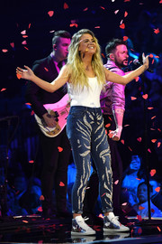 Kelsea Ballerini completed her cute ensemble with a pair of metallic high-top sneakers.