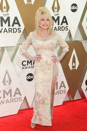 Dolly Parton showed off her ageless figure in a fitted nude gown with all-over beading at the 2019 CMA Awards.