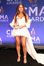 Maren Morris was all legs in a sexy white fishtail dress while posing at the press room during the 2019 CMA Awards.