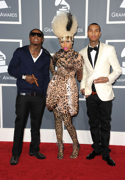Lil Wayne wore a sleek pair of black slacks with a navy cardigan for the Grammy Awards in 2011.