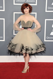 Anna showed her darker side in a dream-like cocktail dress made of tulle and feather at the Grammy Awards.