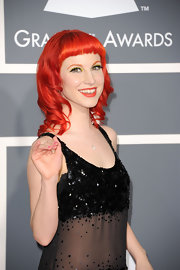 Hayley Williams loves to experiment with her hair color. The singer showed off her vibrant curls and blunt cut bangs at the 2011 Grammy Awards.