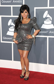 Snooki wasn't afraid to put on the glitz at the Grammys in a sparkling cocktail dress with exaggerated shoulders.