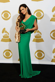 Tia donned the color of the season in a sultry green evening gown at the Grammy Awards.