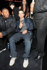 Eminem completed his 53rd Annual Grammy Awards ensemble with a blue leather jacket.