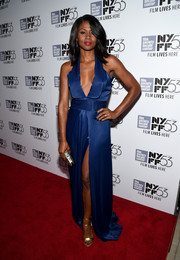 Emayatzy Corinealdi showcased both cleavage and legs in this blue silk gown at the New York Film Fest screening of 'Miles Ahead.'