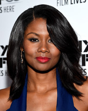 Emayatzy Corinealdi styled her hair with feathered waves for the New York Film Fest screening of 'Miles Ahead.'