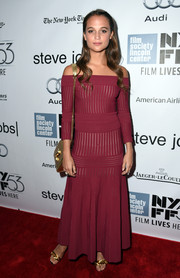 Alicia Vikander went for relaxed sophistication in a burgundy off-the-shoulder knit top by Barbara Casasola during the New York Film Fest premiere of 'Steve Jobs.'