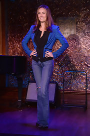 Laura Benanti chose classic flare jeans for her on-stage look at the '54 Below' press preview.