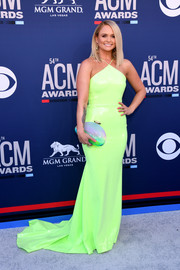 Miranda Lambert lit up the gray carpet with her neon-green Alex Perry halter gown at the 2019 ACM Awards.