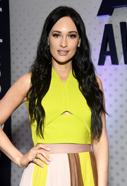 Kacey Musgraves attended the ACM Awards Cumulus/Westwood One Radio Remotes wearing a gold signet with diamond 'K' ring.