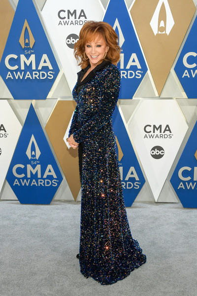 Reba McEntire went for major sparkle in a beaded navy coat, which she wore with black trousers, at the 2020 CMA Awards.