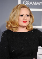 Adele wore her golden locks in bouncy curls at the 54th Annual Grammy Awards.