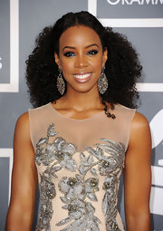 Kelly Rowland swept her glossy voluminous curls back to show-case her ornate earrings at the 54th Annual Grammy Awards.