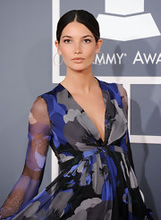Lily Aldridge attended the 54th Annual Grammy Awards wearing a pair of pave diamond forward facing hoop earrings.