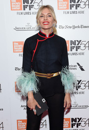 Sienna Miller arrived for the New York Film Festival screening of 'The Lost City of Z' carrying a bedazzled black satin clutch by Roger Vivier.