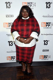 Gabourey Sidibe played matchy-matchy with this plaid pencil skirt and sweater combo.
