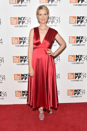 Cynthia Nixon polished off her look with a pair of red and silver strappy sandals.