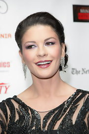 Catherine Zeta Jones paired her gorgeous earrings with a classic bun.