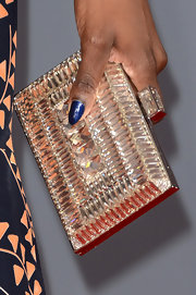 Estelle's shimmery, rhinestone box clutch complemented her glamorous red carpet dress.