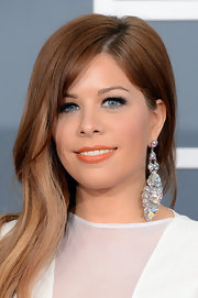 Kady Z's lips popped with this bright coral lipstick with a slight orange undertone at the 2013 Grammys.