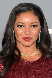 Tamala Jones paired her red sparkly dress with a diamond and yellow gemstone choker necklace with matching earrings to give some extra sparkle.