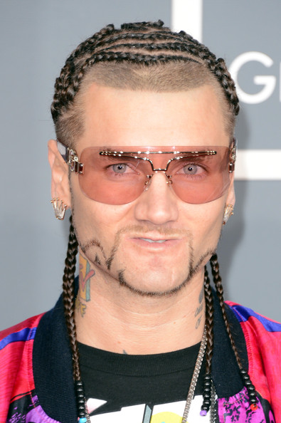 Riff Raff showed his flare from head to toe, especially with these funky pink rimless shades.