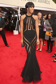Kelly Rowland was all about the sheer cutouts at the Grammy Awards in this black gown with an elongated silhouette.