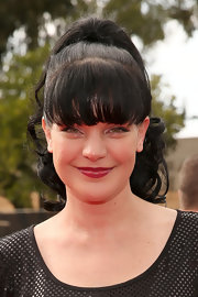 Pauley Perrette kept her look fun and flirty with a high ponytail and thick curls at the 2013 Grammys.