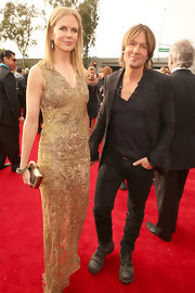Keith Urban toned down his red carpet look with skinny pants and a blazer.