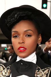 Janelle Monae's bright red lips added a pop of color to her otherwise all black look at the 2013 Grammys.