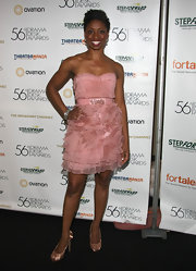 Montego was a frilly beauty in a strapless blush cocktail dress for the Drama Desk Awards.