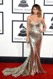 Chrissy Teigen looked phenomenal at the Grammys in a beaded silver strapless gown by Johanna Johnson.