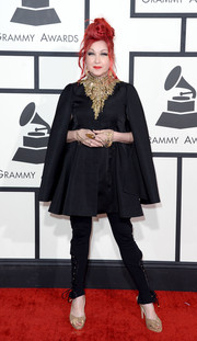 Cyndi Lauper attended the Grammys wearing a caped black Alexander McQueen coat, which she styled with an elaborate statement necklace.