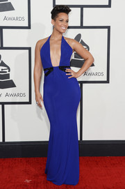 Alicia Keys looked va-va-voom at the Grammys in a figure-hugging, low-cut blue halter gown by Armani Prive.