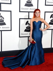 Bonnie McKee looked quite the glamour girl at the Grammys in a strapless blue Memeka by Gustavo Cadile gown with a flowing train.