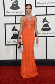 Giuliana Rancic brought a touch of spring to the Grammys red carpet in a floral-themed orange Alex Perry gown with sheer detailing on the bodice.