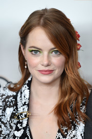 Emma Stone went for a fun beauty look with a swipe of neon-green eyeshadow.