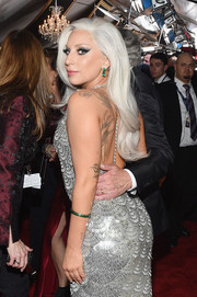 Lady Gaga paired a Lorraine Schwartz gemstone bracelet with a beaded silver dress for her Grammy Awards look.