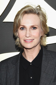 Jane Lynch opted for a casual razor cut when she attended the 2015 Grammys.