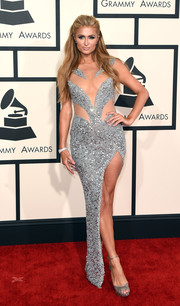 Paris Hilton vamped it up at the Grammys in a Yousef Al-Jasmi beaded gown with a sheer-panel bodice and a hip-grazing slit.