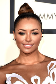 Kat Graham wore her hair in a severe top knot during the Grammys.