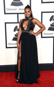 Ashanti put plenty of skin on display in a high-slit black cutout gown during the Grammys.